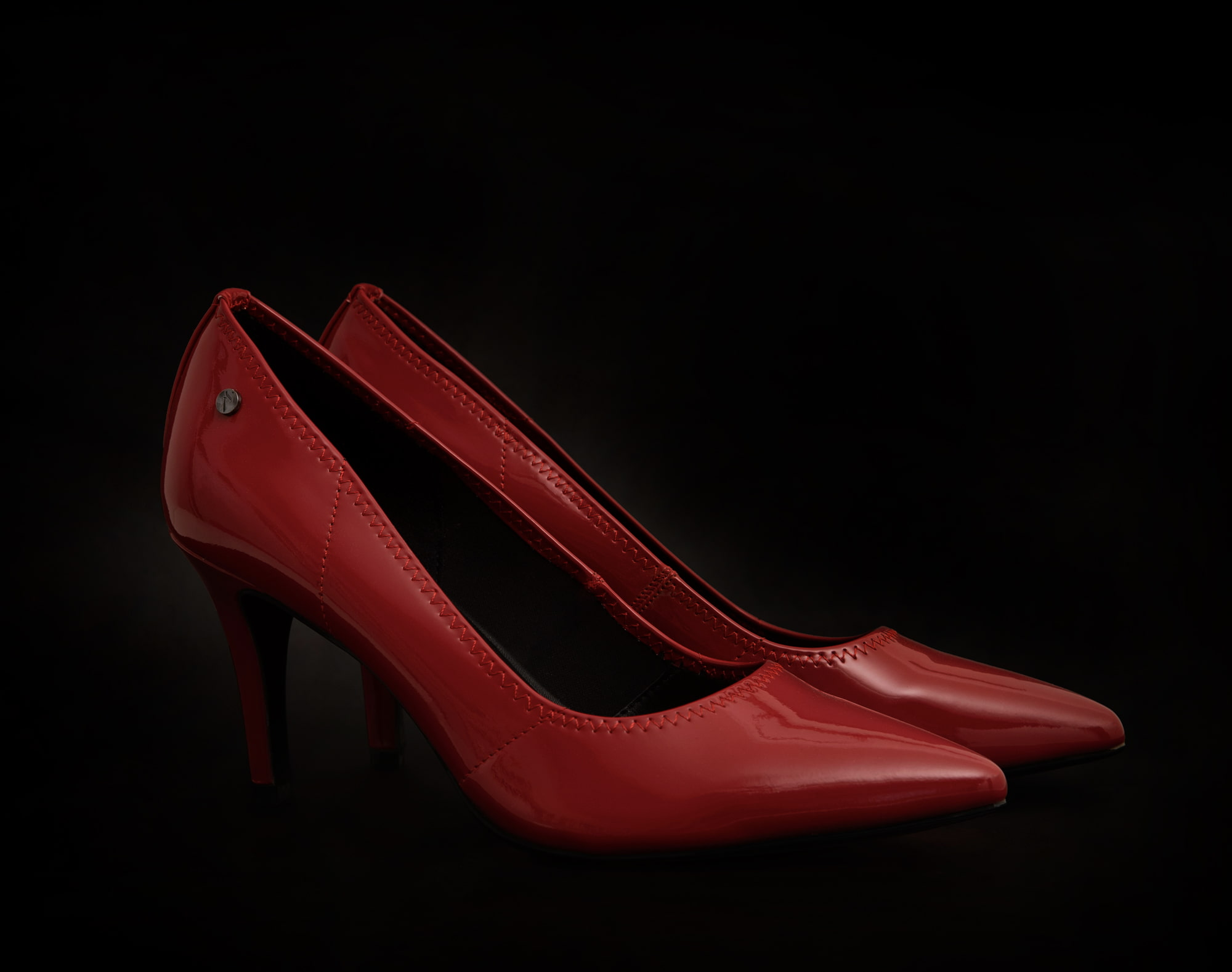 red pumps with black background