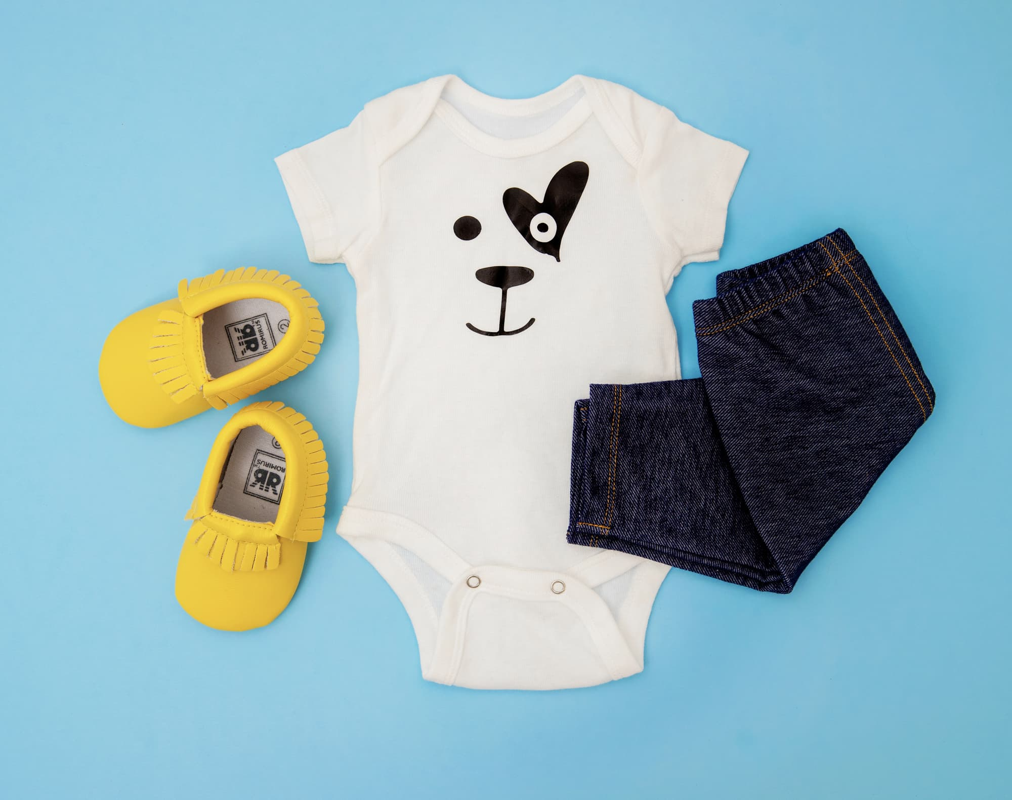 flat lay of childs outfit on blue background