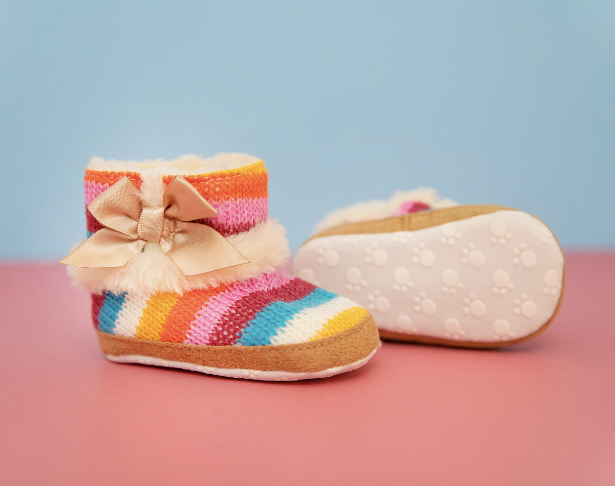 product baby apparel photography: colorful fur boots