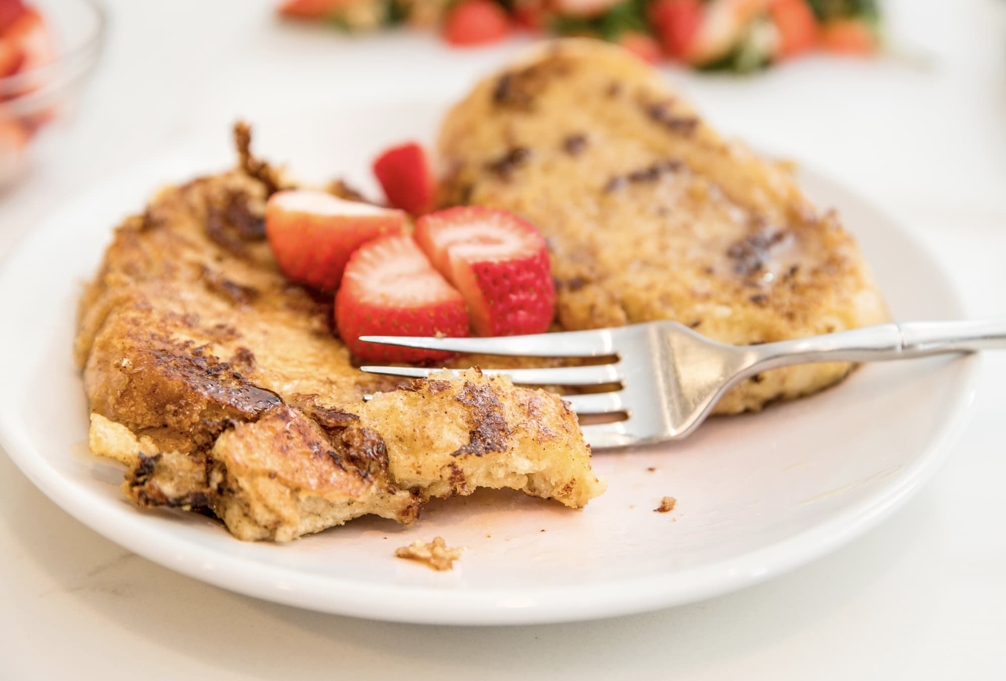 plate of french toast and strawberries
