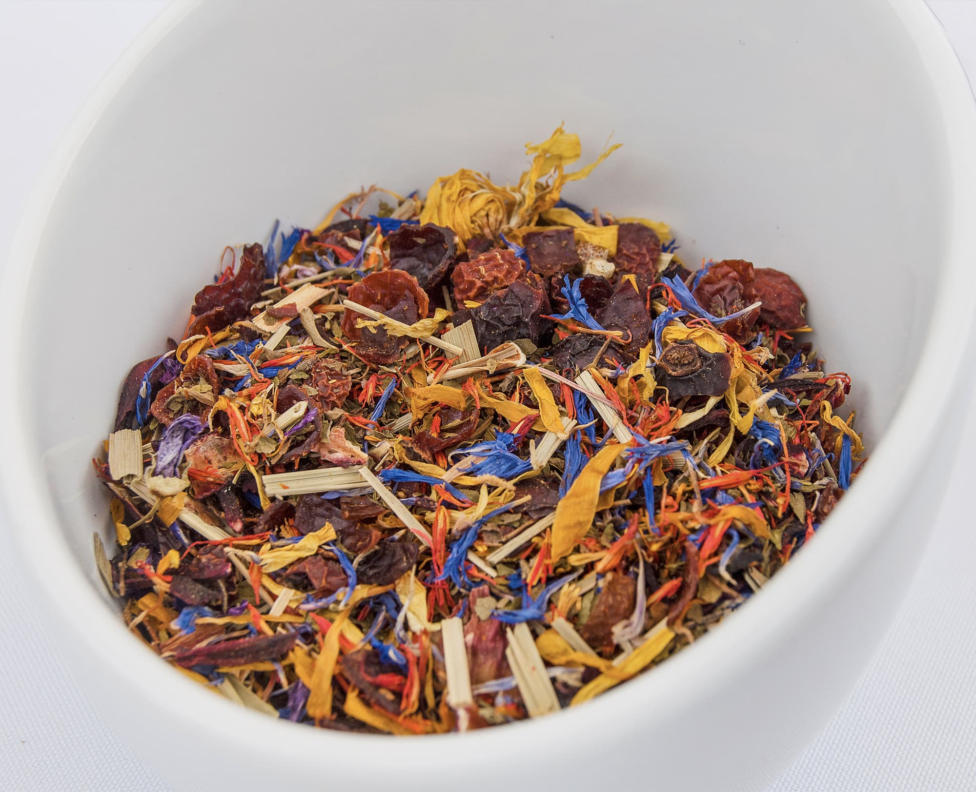 colorful tea leaves in white bowl