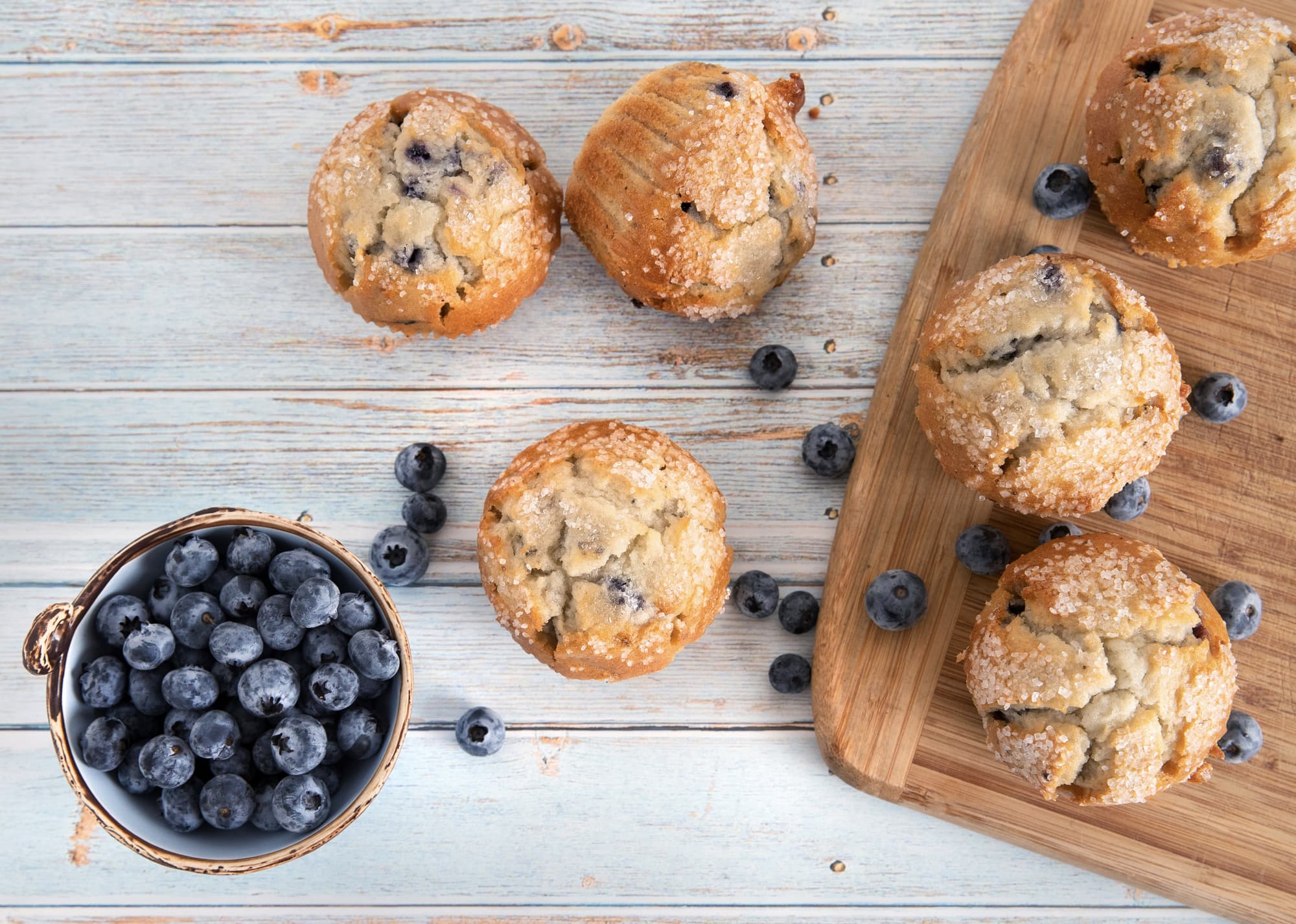 blueberry muffins on wood table