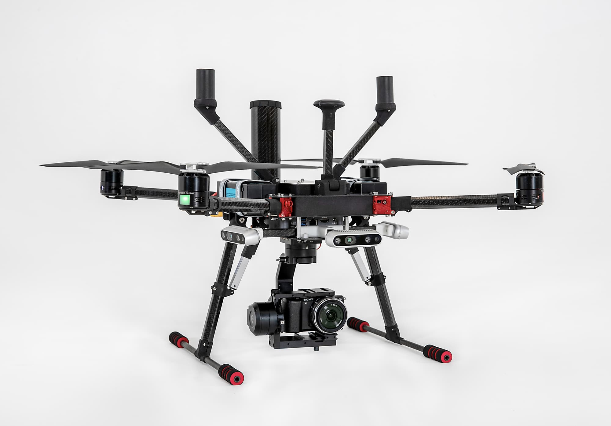 Helo-copter drone photographed in studio against white background