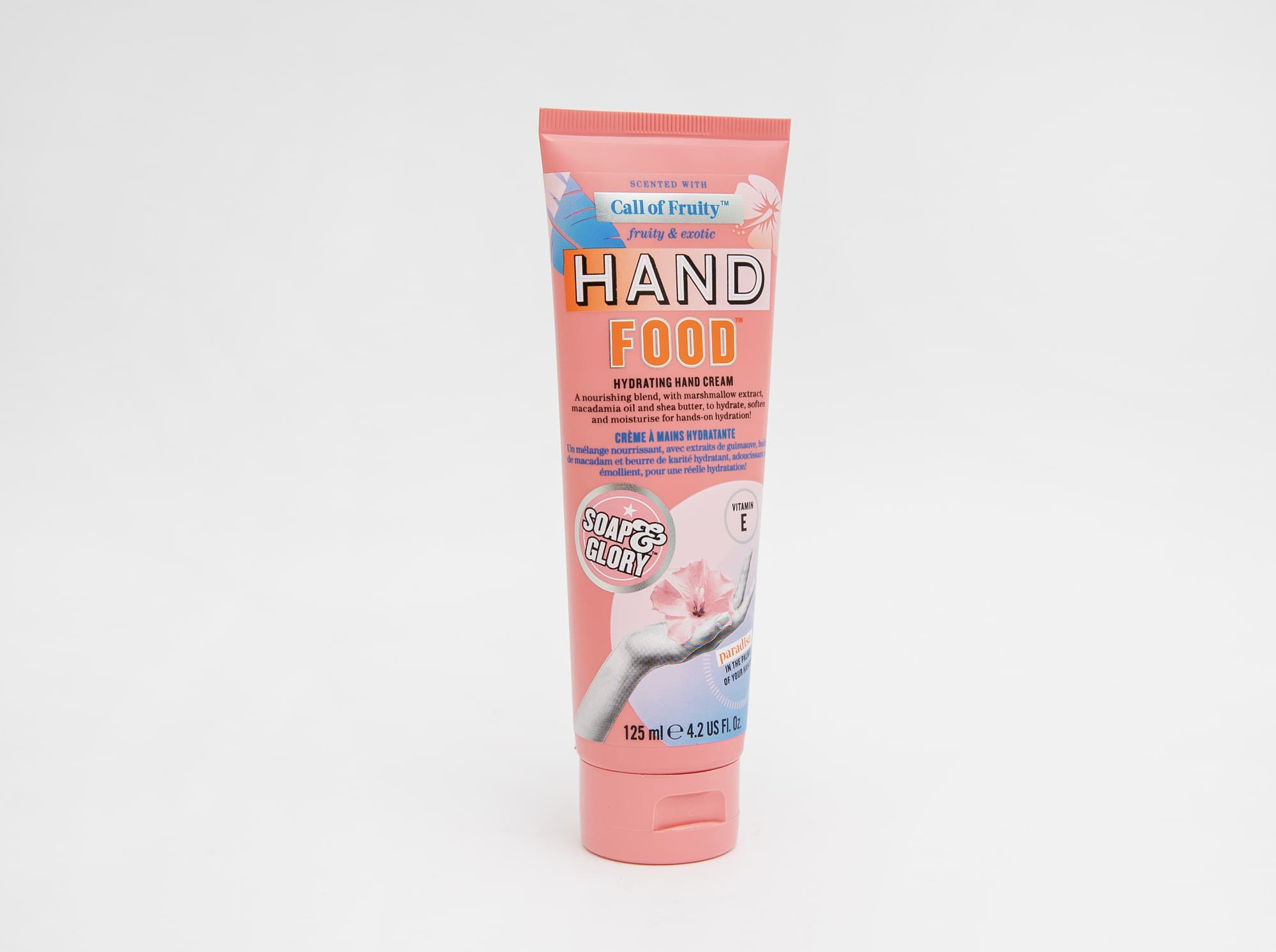 pink hand lotion on white background