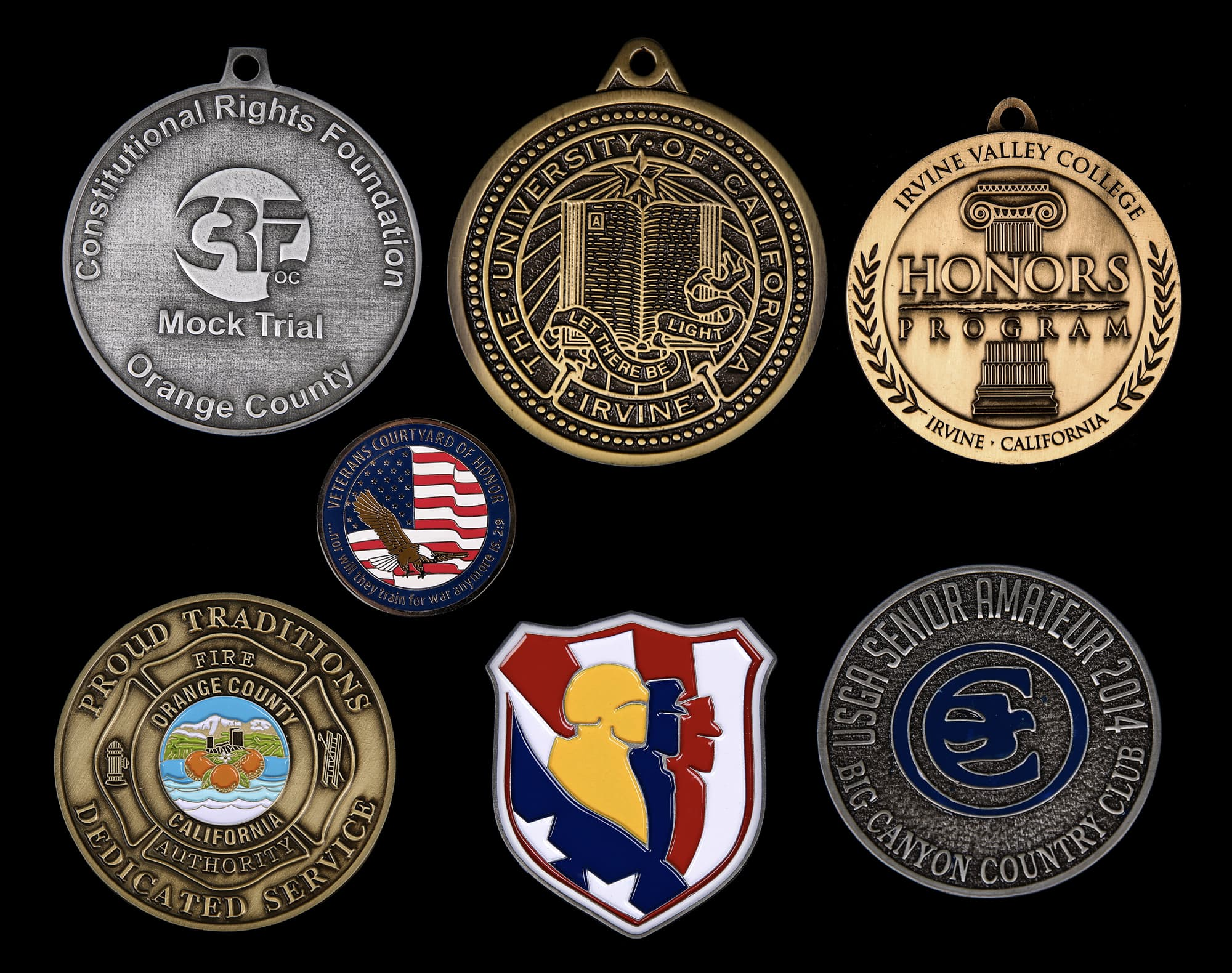 various cast bronze medals on black background