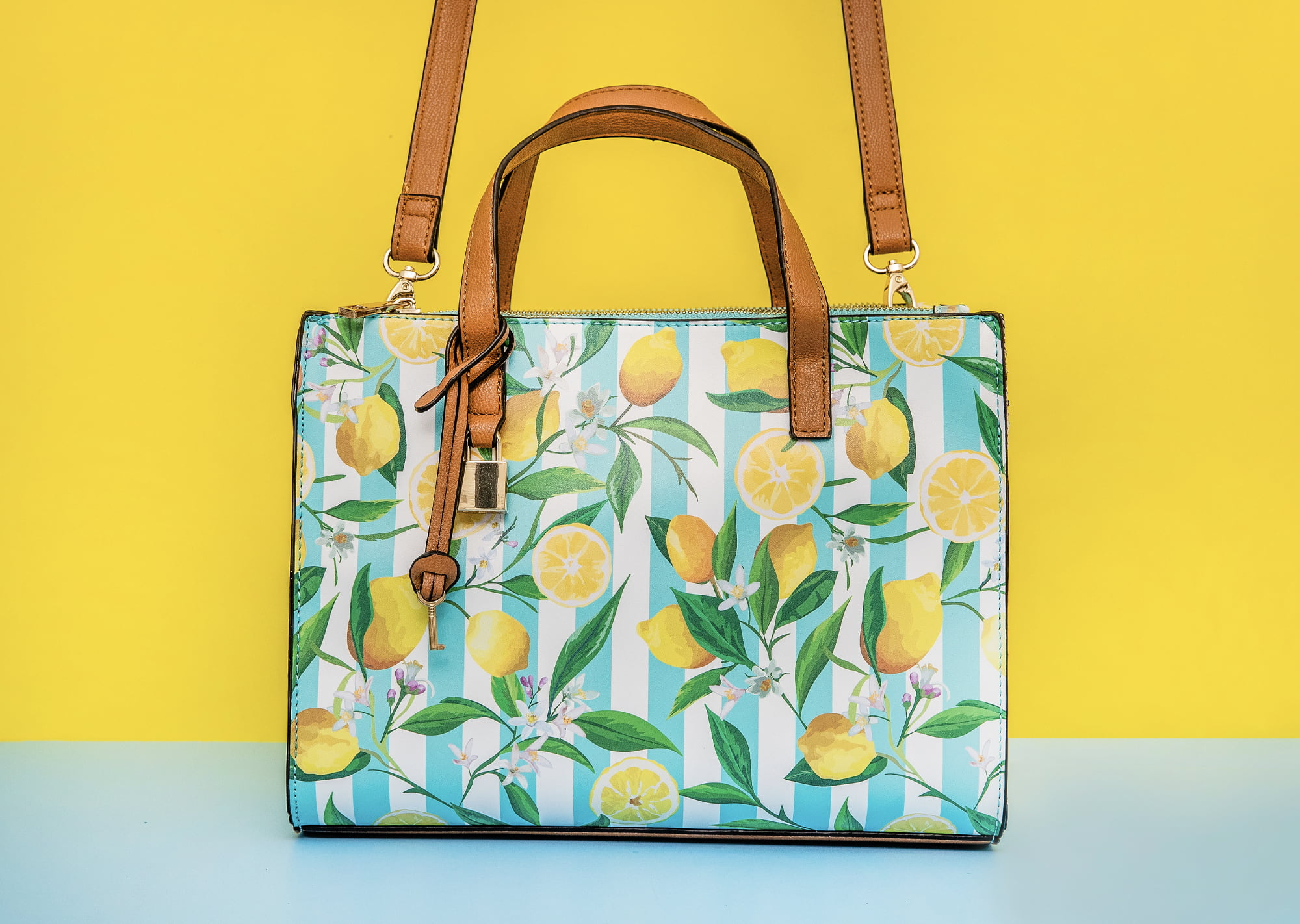 professional product photo of yellow and blue lemon purse